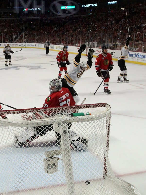 Chicago Blackhawks goalie Corey Crawford (50) is unable to stop the winning goal, shot by the Boston Bruins' Daniel Paille in overtime in Game 2 of the NHL's Stanley Cup Finals at the United Center in Chicago on Saturday night, June 15, 2013. Boston's 2-1 win tied the series, 1-1.
