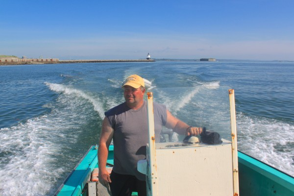 Tom Roth of Buxton, owner of VitaminSea, drives a skiff from Portland to a kelp bed off Cape Elizabeth to harvest sugar kelp on May 30, 2013. He uses the kelp in a variety of VitaminSea products, including culinary spices and animal feed supplements.