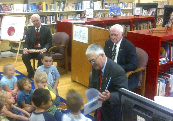 Retired U.S. Army Maj. Gen. Earl Adams (right) reads a book to Kathryn Griffith's pre-kindergarten class at Downeast Elementary School in Bangor on Tuesday. Retired Air Force Brig. Gen. Ralph Leonard (center) and retired Army Brig. Gen. Robert Carmichael (left) also read books to the children. All three called on Congress to support a White House proposal to add early education funding. BDN photo by Nok-Noi Ricker