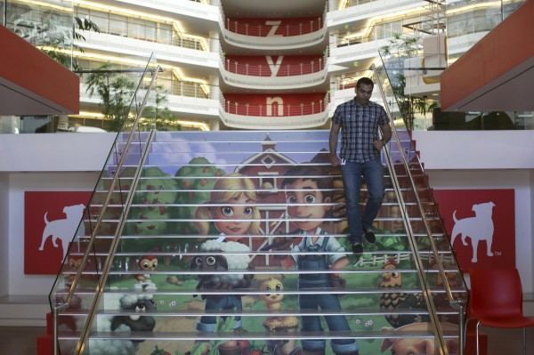 Player avatars from Zynga's FarmVille 2 are seen on a stairway at the entrance to Zynga headquarters in San Francisco, Calif., on April 23. Zynga announced Monday it would be laying off 520 employees, about 20 percent of the company's workforce.