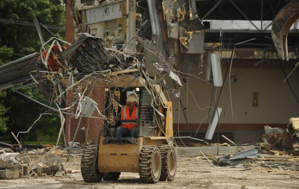 Debris from the Bangor Civic Cener is pulled apart and sorted on site before being recycled as the Bangor Civic Center and Bangor Auditorium are dismantled piece by piece on Thursday.