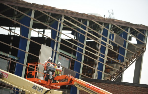 Workers remove asbestos panels from the girders of the Bangor Auditorium exposing the interior to the outdoor elements.The defunct community facility in Bangor is being dismantled and is expected to take 6 weeks to compete.