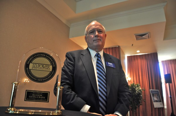 Jim Conlon, CEO of Bangor Savings Bank, with the 2013 award from J.D. Power and Associates for being the highest-scoring bank in New England when it comes to customer satisfaction.