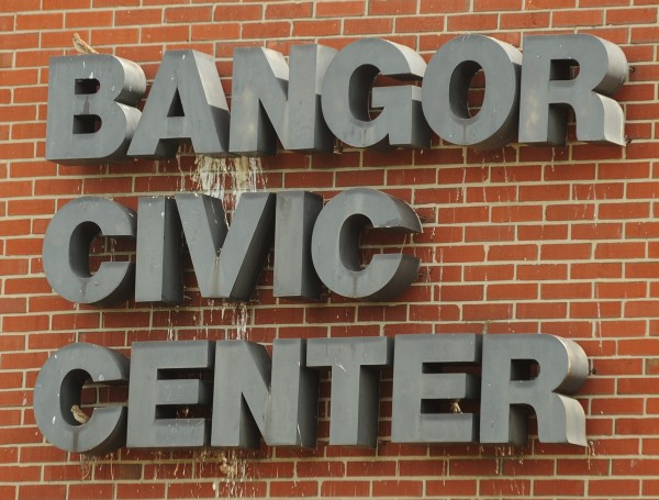 Birds continue to build in the letters of the Bangor Civic Center sign as heavy machinery eats away at the brick wall the sign hangs on on Thursday. Dismantling of the old auditorium is on schedule and should take about 6 weeks to complete. A 200 space parking lot will be paved over the former site.