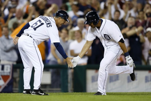 Detroit Tigers' Jhonny Peralta (27) receives congratulations from third base coach Tom Brookens (61) after he hit a two-run walk-off home run in the ninth inning against the Boston Red Sox at Comerica Park in Detroit Thursday night. Detroit won 4-3.