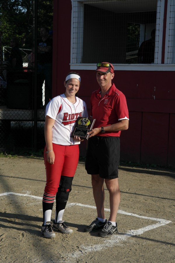 South Portland's Dancia Gleason receives the award as Miss Maine Softball from Scarborough coach Tom Griffin at Cony High School Thursday night.