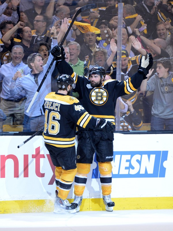 Boston Bruins defenseman Johnny Boychuk (55) celebrates with center David Krejci (46) after scoring a goal against the Chicago Blackhawks during the third period in game four of the 2013 Stanley Cup Final at TD Garden. The Blackhawks won 6-5 in overtime.