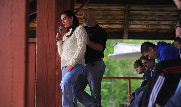 Jody Arno (left) supported by her husband Kirt Stockley talks about her son during the ceremony celebrating the life of Dacano Arno at the Kiwanis Park in Dover-Foxcroft Friday afternoon. Dacano died earlier this week in a swimming accident.