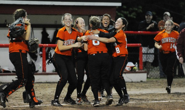 Members of the Skowhegan softball team celebrate their 2-0 victory over Bangor in the Eastern Maine Class A final on Thursday in Augusta.