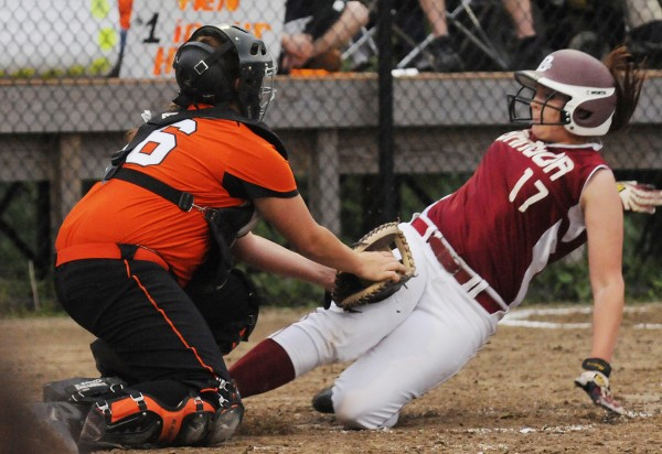 Bangor's Kelsey Pendergast is tagged out at home by Skowhegan's Andrea Quirion during third-inning action in Augusta on Thursday during the Class A regional championship. Skowhegan won 2-0.