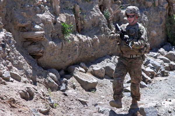 U.S. Army Sgt. Corey Garver, of Topsham, walks around a village in Paktia province, Afghanistan, on May 29, 2013, in this photo taken by Army photographer Spc. Robert Porter, which was posted on the Department of Defense website as part of a slideshow earlier this month. Garver died on June 23, 2013 from an improvised explosive device in Afghanistan while assigned to the 101st Airborne Division's Company B, 1st Battalion, 506th Infantry Regiment, 4th Brigade Combat Team.