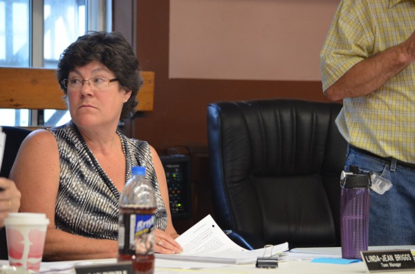 Dexter Town Manager Linda-Jean Briggs looks over at a town councilor during a public hearing for a moratorium on east-west corridor development on Thursday.