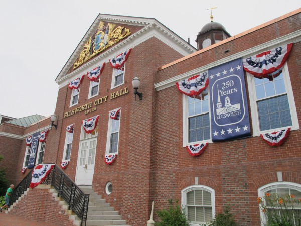 Ellsworth City Hall, decked out with bunting and banners to commemorate the 250th anniversary of the first permanent settlement in what would become Hancock County's largest city.