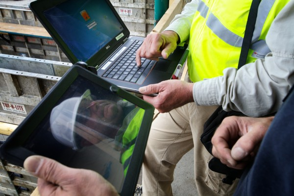 Portland code enforcement officer Don McPherson (left) logs into his laptop Friday as he goes over electronic site plans with Ed Hume of PC Construction on Diamond Street. McPherson now files his code inspections from the field with his laptop.