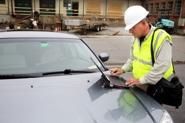 Don McPherson, a Portland code enforcement officer, files an inspection on Diamond Street with his laptop computer on Friday.