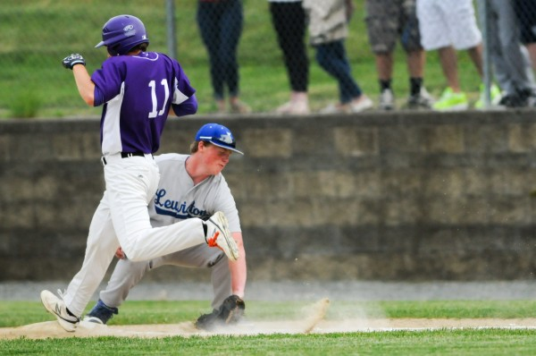 Hampden Academy's Samuel Ward (left) is beaten to first base by a throw to Lewiston's Brian Wigant on Thursday.