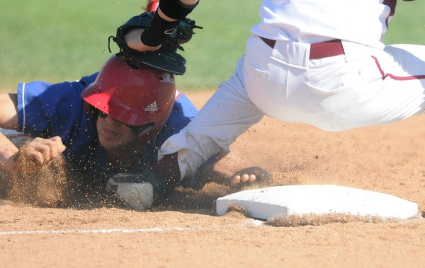 Messalonskee's  Devin Warren is tagged out sliding into third base by Bangor's Carl Farnham on Wednesday.