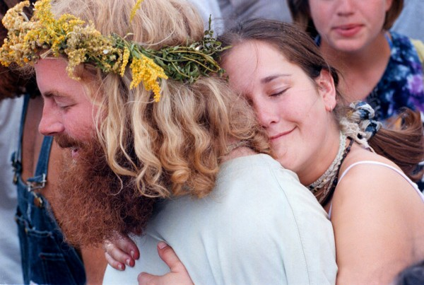 A couple of Phish fans embrace while absorbing the atmosphere of the concert during the band's opening set in August 1998.
