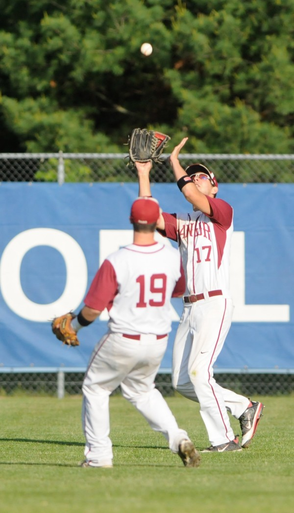 Bangor's Tyler LaPlante (right) makes a catch after waving off teammate  Bryan Rouleau on Wednesday.