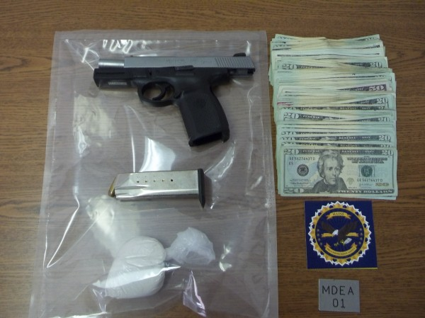 A .40-caliber handgun, $4,600 in cash and 2.5 ounces of heroin confiscated in a search of two hotel rooms rented by Wayman Sparrow, who was arrested on three charges Saturday night.