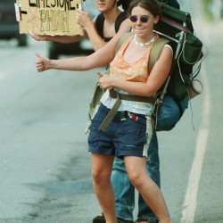 Jesse Brown-Collins of Damariscotta and Christine Leonard of Boothbay Harbor seek a ride from Bangor to Limestone in August 1997.
