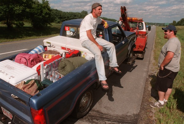 Dan Martineau (left) and Tony Rossi, both of Chicopee, Mass., plan other modes of transportation to The Great Went after their truck blew its engine on I-95 in Bangor in August 1997. They hoped to rent a van to finish the trek.