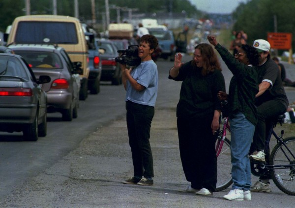 Limestone residents (from left) Noella Hafford, Cindy Beausoleil, Dorothy Alston and Ron Beausoleil greet Phish phans on the final mile in August 1997.