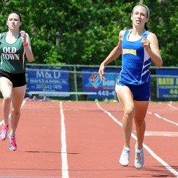 Hermon's Kaitlin Saulter, center, pulls away from the field in the final stretch of the 400 meter during Saturday's Class B state championship meet at Morse High School in Bath.