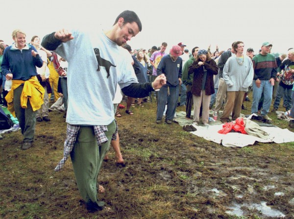 Phish phans dance in the mud created by the morning's rain during a Saturday afternoon concert in August 1997.