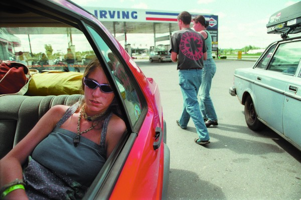 Exhausted Phish fan Helen Miller of Asheville, N.C., sleeps soundly (above) in the back of a car parked in the Irving parking lot in August 1997 in Houlton.