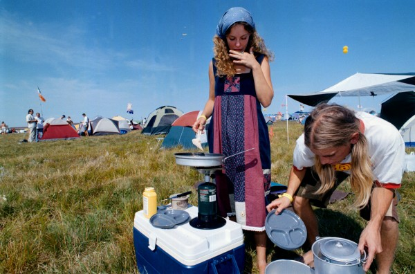 Bridget Cummings and Kevin McCarthy of Madison, Wis., prepare breakfast in August 1998 at the Lemonwheel camping area in Limestone.
