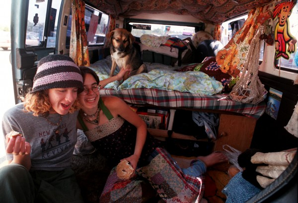 Alison Ramadei (left) of Evergreen, Colo., and Julia Armstrong of Conifer, Colo., eat breakfast in Armstrong's van at Shaw's supermarket on Springer Drive off Interstate 95 in Bangor in August 1998. They had been traveling for three weeks. &quotThis is the way to live,&quot Armstrong said.