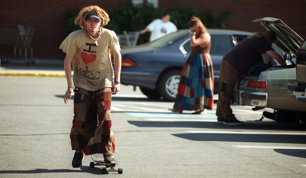 Mike Orszulak of Eugene, Ore., skateboards past shoppers loading their cars with supplies in the Shaw's supermarket parking lot on Main Street in Bangor in August 1998.