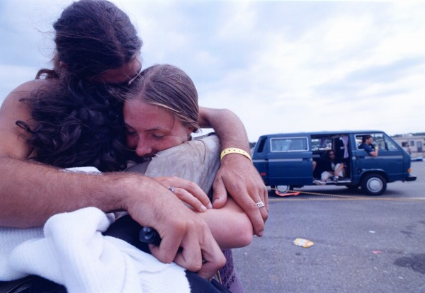 Julia Walsh (right), of South Amboy, N.J., is hugged by Stephen Fountaine and Courtney Meehan, both of Haverhill, Mass., as they say goodbye to each other in the camping area at Loring Commerce Centre the morning after the Phish concert in August 1998.