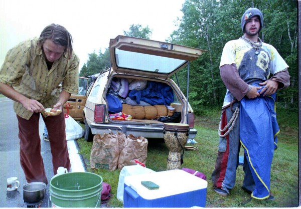 Jarvis Fosdick (left) of Colorado cooks hot dogs for lunch in the rain in August 1997 as he and friend Moe Lafreniere awaited the opening of the east gate at the former Loring Air Force Base for the weekend's Phish concert.