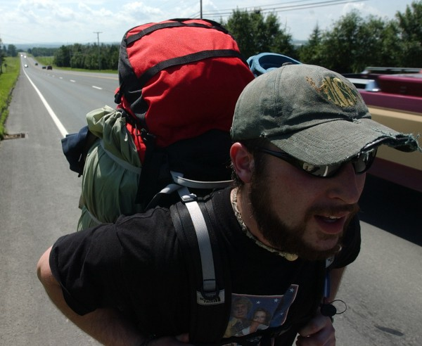 &quotA lot of people drive by and wave but no one has stopped yet,&quot said Tim Bayer of Anchorage, Alaska, as he walks between Presque Isle and Limestone to the It show in August 2003 wearing his tattered Phish hat he bought during the 1998 Lemonwheel concert at Loring Commerce Centre.