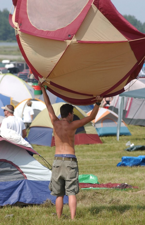 It's wet and I'm having a blast,&quot said Andy Watson of Wakefield, Vt., as he searches for a dry spot to set up camp at the Loring Commerce Centre in Limestone in August 2003. Rain Thursday night left standing water throughout the grounds.