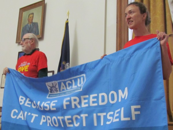Douglas Cowie (right) and Rachel Healy of the ACLU of Maine hold a banner celebrating the U.S. Supreme Court's decision Wednesday striking down the Defense of Marriage Act as unconstitutional during a rally at Portland City Hall.