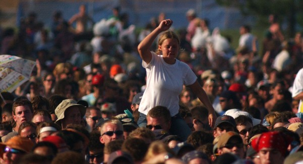A Phish fan gyrates on the shoulders of a man during the opening song of Phish's It festival in Limestone in August 2003.