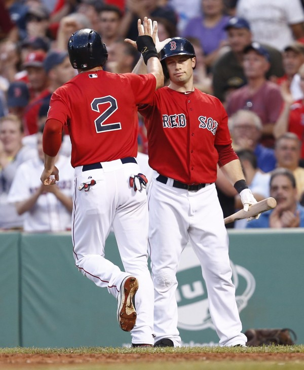 Jacoby Ellsbury (2) celebrates with Daniel Nava after scoring a run during the second inning against the Toronto Blue Jays Friday night at Fenway Park in Boston.