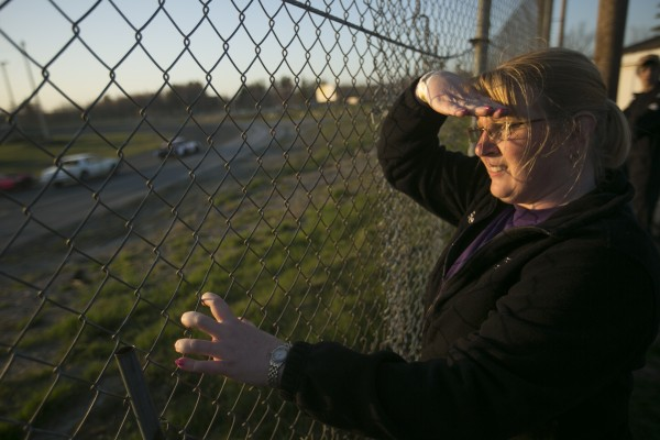 Tonya Berry watches her son, Alex, race at Speedway 95 in Hermon on May 4. Alex Berry has collected three third-place finishes and a fifth in 19 Street Stock races this season.