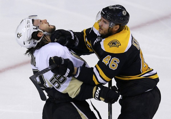 Boston Bruins' David Krejci (R) shoves Pittsburgh Penguins' Kris Letang during the second period in Game 3 of their NHL Eastern Conference finals hockey playoff series in Boston. The Bruins won 2-1 in two overtimes.