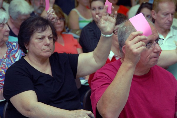 About 75 residents endured a muggy Schenck High School auditorium to vote through the town and school budgets for East Millinocket on Tuesday, June 25, 2013.