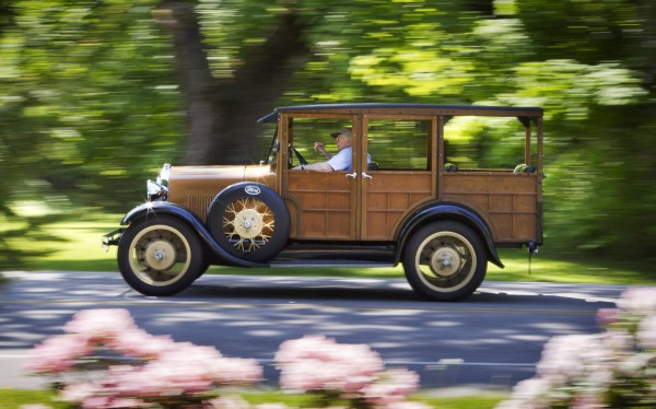 Lester Noyes travels down Route 88 in his 1929 Model A Ford station wagon, commonly known as a Woody, Sunday, June 2, 2013, in Falmouth, Maine. Noyes is part of a group of antique car enthusiasts who assemble for outings most Sundays, leaving Skillins Nursery in Falmouth, at 8 a.m.