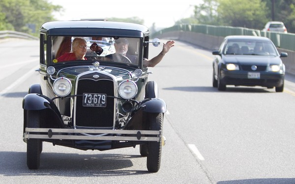 John and Sandy Hodgdon of Gorham acknowledge passing motorists on Interstate 295 in their 1931 Model A Ford pickup truck, Sunday, June 2, 2013, in Portland, Maine.
