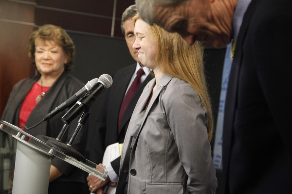Abigail Fisher (second right), a suburban Houston student who asserted she was wrongly rejected by the University of Texas at Austin while minority students with similar grades and test scores were admitted thanks to the admissions policy, pauses while speaking at a news conference flanked by her parents Rosalie (left) and Richard Fisher (right), as well as Edward Blum (second left), director of the Project on Fair Representation, in Washington on Monday.