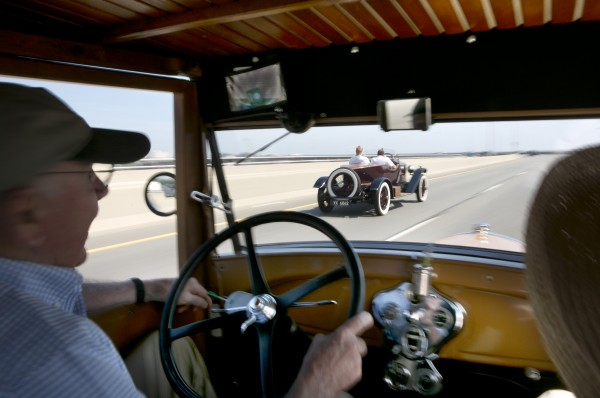 Lester Noyes, driving a 1929 Model A Ford, is passed by David Glaser in his 1928 Rolls Royce on the Casco Bay Bridge, Sunday, June 2, 2013, in Portland, Maine.