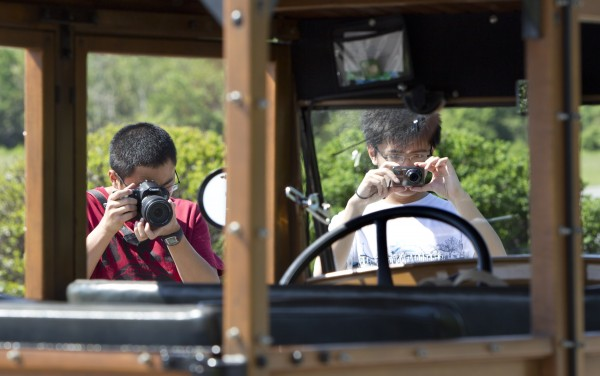 Visitors snap pictures of Lester Noyes' car at Fort Williams Park in Cape Elizabeth, Maine.