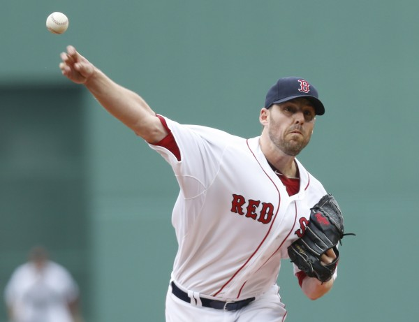 Red Sox pitcher John Lackey (41) delivers a pitch during the first inning against the Colorado Rockies at Fenway Park on Wednesday.