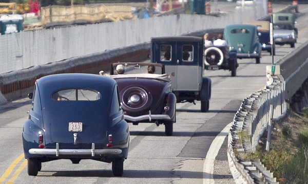 A group of antique automobiles travels south on Route 1 in Falmouth, Sunday, June 2, 2013.